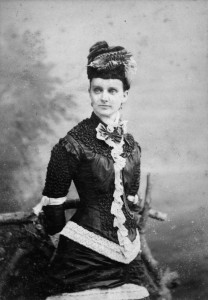 Lady Wears Hat Trimmed with Stuffed Bird